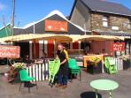Enjoy a relaxing coffee and home baking in morning sunshine in Sneem village