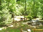 Picnic table ,swing, firepit in front of cabin