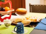 Brazilian typical breakfast with fruit ,different types of bread and cheese . Hot coffe wakes up !