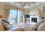 Lounge with vaulted ceiling ,Ceiling fans,Air con, log burner,marble floor, Tv,DVD and sterio