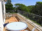 Sunny balcony with bay views
