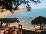 Diaskara beach with its peaceful beachside taverna, parasols and hammocks
