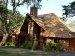Chalet 233 at the Kruger Park Lodge sheltered from the summer heat by wild fig trees