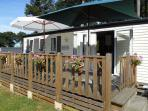 Relax in the glorious sunshine on the ample decked outdoor area