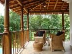 Relax on the large terrace with roof constructed in teak wood and terracota tiles