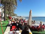 La Red Restaurant in December.   The apartment block is behind the palm tree on the left.