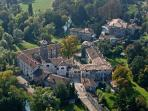 Airview castle of Strassoldo di Sopra complex with medieval borgo and park