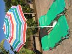 beach loungers, parasol, beach chairs and children's pool toys