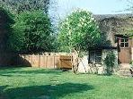The view from Stable Cottage - sunny cottage garden with BBQ. annex available - sleeps 2.
