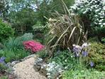 Part of the pretty back gardens,your 2 bedrooms look onto this.