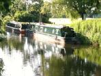 Canal boats along the river walk in Whittlesey a short distance from the cottage