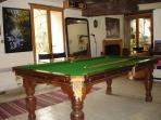 Snooker table in games room by pool