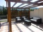 Newly built pergola providing shade from the sun.