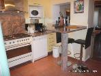Well-equipped kitchen adjacent to living/dining room
