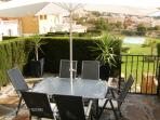 seating area with barbecue, back garden