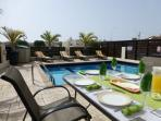 Enjoy al fresco dining and a drink by the pool
