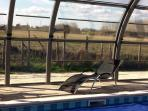 Looking from the pool on to the countryside. The cover is new, more photos to follow.