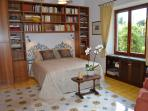 White Room, double, view to the garden, illustrated books of art, painting, archeology