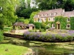 The quintessentially English village of Bibury with it's row of Alm's houses & trout farm.