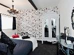 En suite double bedroom tastefully decorated in black and white