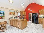 Large family kitchen with American style fridge freezer