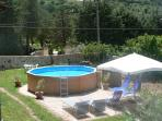 Round pool above ground with professional sand filter