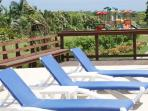Our Lovely Turquoise Infinity Community Pool with plenty of Lounge Chairs - Children Playground