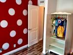 Mickey inspired kid's room complete with toys and dress up clothes