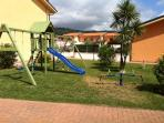 Childs safe playing area- swings,slide and climbing frame