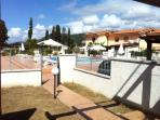 View from our house towards the pool area and across to the entry gate.