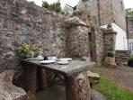 Why not have a meal outside by the Stone Wall?