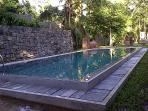 32 feet long wet edged swimming pool, perfect for cooling dips on hot tropical days and nights.