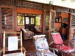 Rocking chair and sun-loungers on veranda