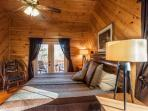 King Master bedroom upstairs with a private deck overlooking the mountain tops