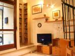 Living-entry area with tv and many italian book