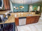 The kitchen has a dishwasher, stove, oven, microwave, and refrigerator with ice maker.
