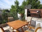 Large front terrace (twice as large as photo).  Note large parilla (BBQ)