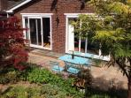 Looking back at the house from the garden - the patio is a good sun trap!