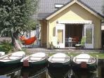 Open doors to terras. Fatboy hammock and garden furniture.