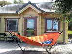 Relax on the Fatboy hammock and garden furniture.