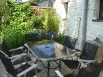 Patio, private and secluded. Lovely afternoon sun trap.