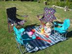 Fold out chairs (for children and adults) are provided along with a beach blanket for guests