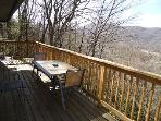 30ft.deck with table and barbeque.