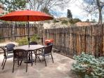 Back patio with outdoor seating and BBQ grill