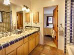 Master bath with shower/tub combo and double sinks