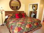The master bedroom has 1 king bed and private bath.