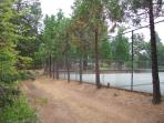 Tennis courts with the community pool behind it.  This is behind the cottage.