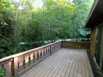 Large deck with picnic table for summer enjoyment!