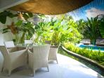 Open Dining surrounded by a fishpond, overlooking to pool and lush tropical gardens.