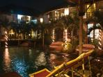 Villa and pool view at night